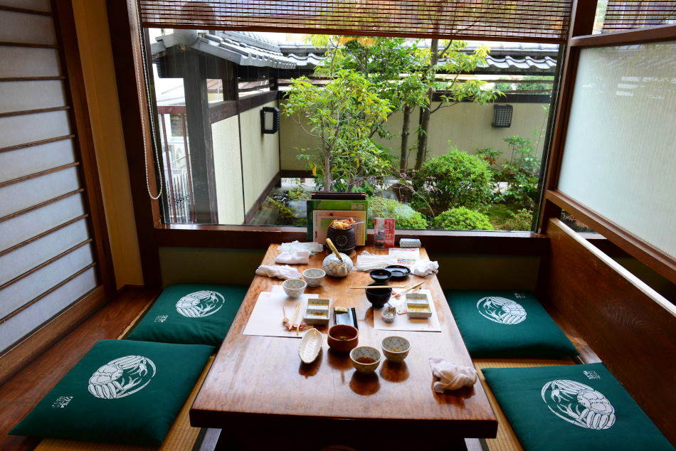 The table setting was Japanese in style with views to a small Japanese garden. & Tadao | Blue Lapis Road